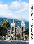 Small photo of Banos, Ecuador - November 24, 2017: Catedral Church of the Virgin of the Holy Water (Reina del Rosario de Agua Santa), in the Central Plaza of the city of BanÌ?os de Agua Santa, Ecuador