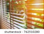 wooden blinds with sun light. | Shutterstock . vector #762510280