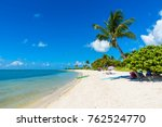 sombrero beach with palm trees... | Shutterstock . vector #762524770