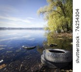 Abandoned Tires On The Lake Of...