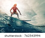 young surfer rides the ocean... | Shutterstock . vector #762543994