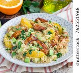 Small photo of Quinoa, orange and chicken salad tabbouleh, square format