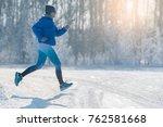 winter jogging   winter running ... | Shutterstock . vector #762581668
