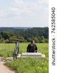 Small photo of cyclists in a distance view on a summer sunny day in south german countryside near city of munich and stuttgart