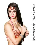 Small photo of Portrait young orient eastern girl. Perfect make-up. Woman wearing traditional indian clothing with fashionable accessories bijouterie armlet. Beautiful breasts. Decoration on the head. Necklace