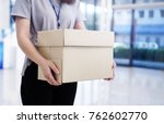 woman holding the box unemployed | Shutterstock . vector #762602770