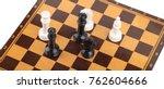 wooden checkerboard with figures | Shutterstock . vector #762604666