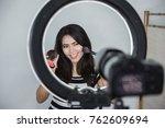 beauty blogger. makeup tutorial.... | Shutterstock . vector #762609694
