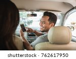 happy taxi driver showing... | Shutterstock . vector #762617950