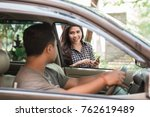 driver picking up his customer... | Shutterstock . vector #762619489