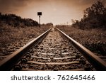 Vintage railroad tracks sepia color in grunge and retro style and old picture