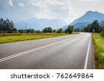 asphalt road and mountains on... | Shutterstock . vector #762649864