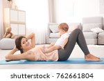 young mother doing yoga with... | Shutterstock . vector #762661804