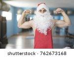 strong santa claus posing in... | Shutterstock . vector #762673168