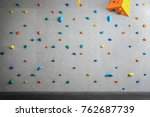 Grey Wall With Climbing Holds...
