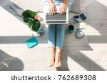 woman using laptop at home | Shutterstock . vector #762689308