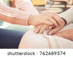 senior woman and young... | Shutterstock . vector #762689374