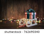 Gift Boxes With Ribbons On Sled ...