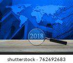 magnifying glass with 2018 text ... | Shutterstock . vector #762692683