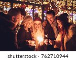 three couple with sparklers... | Shutterstock . vector #762710944