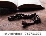 rosary and cross on the bible... | Shutterstock . vector #762711373