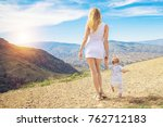 mother with child standing on... | Shutterstock . vector #762712183