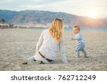 laughing child boy run to his... | Shutterstock . vector #762712249