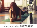 exercise woman doing plank at... | Shutterstock . vector #762715753
