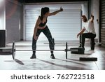 young muscular couple lifting a ... | Shutterstock . vector #762722518