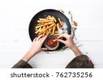 childs hand dipping a potato... | Shutterstock . vector #762735256