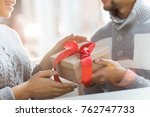 hands of young man giving xmas...   Shutterstock . vector #762747733
