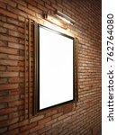 a blank frame on brick wall... | Shutterstock . vector #762764080