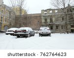 city after blizzard. cars... | Shutterstock . vector #762764623
