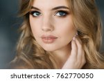 young girl with wavy hair and... | Shutterstock . vector #762770050