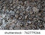muddy and frozen ground texture ... | Shutterstock . vector #762779266