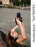 Small photo of Urban photoshoot woman walk roof concept. Photographer lifestyle. Working process
