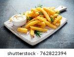 homemade baked potato fries... | Shutterstock . vector #762822394