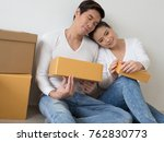 happy couple smiling  packing... | Shutterstock . vector #762830773