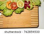 word cook from raw food lies on ...   Shutterstock . vector #762854533