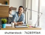 young freelancer taking photo... | Shutterstock . vector #762859564