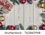christmas gift boxes and fir...   Shutterstock . vector #762865948
