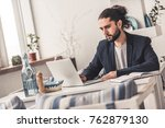 handsome young businessman with ... | Shutterstock . vector #762879130