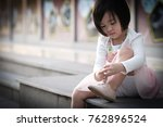 the young girl is tying... | Shutterstock . vector #762896524