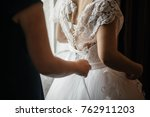 a beautiful bride is gathered... | Shutterstock . vector #762911203