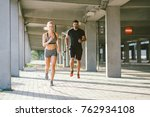 athlete couple running at the... | Shutterstock . vector #762934108