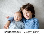 happy brothers  baby and... | Shutterstock . vector #762941344