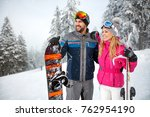 happy male and female on skiing ... | Shutterstock . vector #762954190