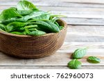 Fresh Baby Spinach In A Wooden...