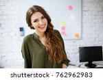 happy it student standing in... | Shutterstock . vector #762962983