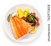 fried salmon and vegetables on... | Shutterstock . vector #762971818